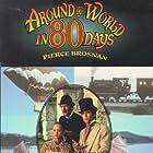 Pierce Brosnan, Eric Idle, and Julia Nickson in Around the World in 80 Days (1989)