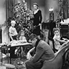 James Stewart, Donna Reed, Carol Coombs, Jimmy Hawkins, and Larry Simms in It's a Wonderful Life (1946)