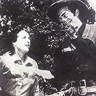Jack Elam and Mercedes McCambridge in The Dakotas (1962)