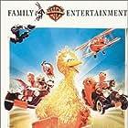 Chevy Chase, Frank Oz, Sandra Bernhard, John Candy, Jim Henson, Joe Flaherty, Waylon Jennings, Martin P. Robinson, and Caroll Spinney in Follow That Bird (1985)