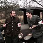Production Shot: Walt meets two new friends in France as part of the ambulance core in World War I.