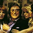 Michael Caine, Anna Marie Goddard, Nina Kaczorowski, Nikki Ziering, and Tammy Vanderpool in Austin Powers in Goldmember (2002)