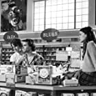 Liv Tyler, Anthony LaPaglia, and Johnny Whitworth in Empire Records (1995)