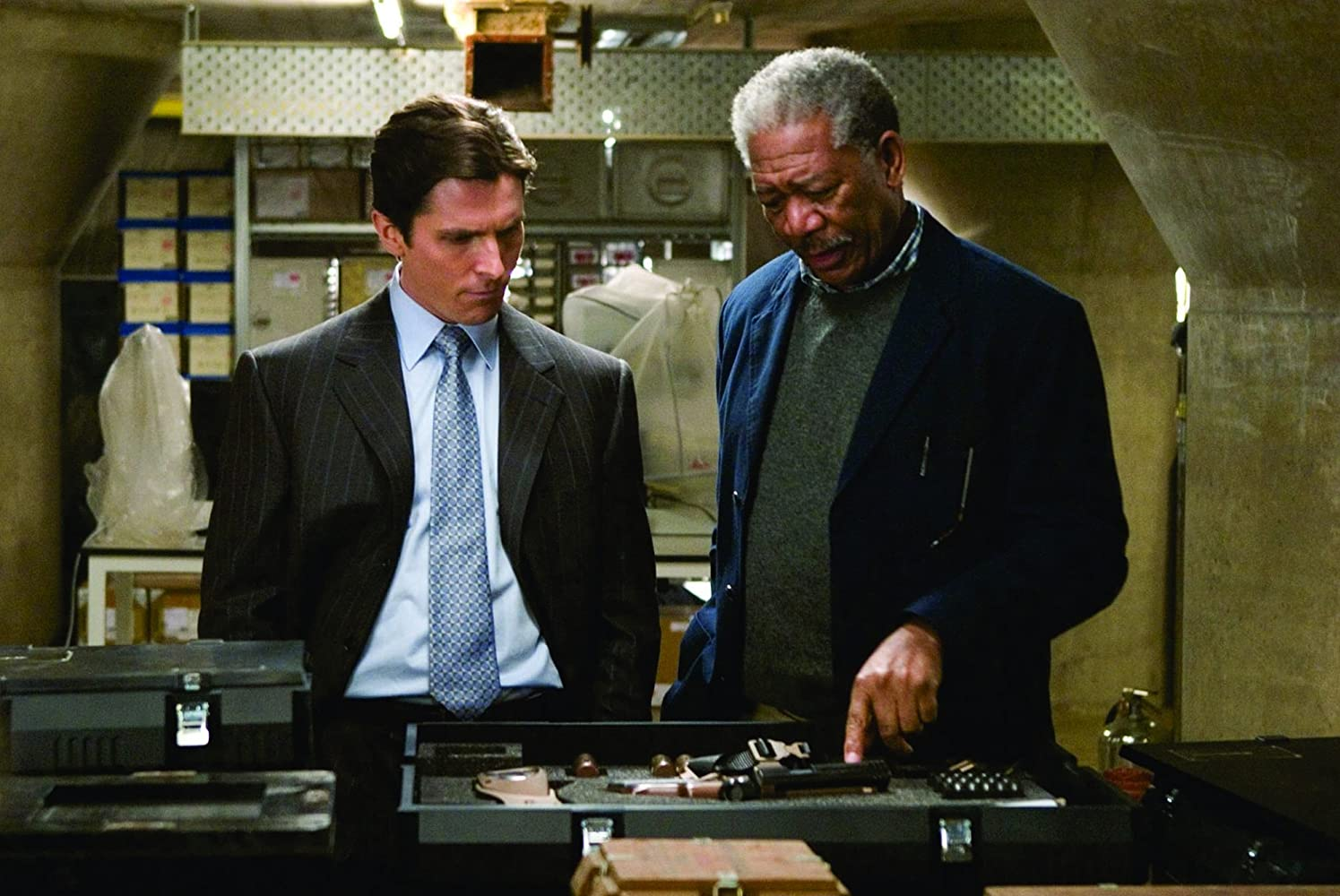 Morgan Freeman and Christian Bale in Batman Begins (2005)