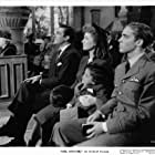 Greer Garson, Richard Ney, Walter Pidgeon, Christopher Severn, and May Whitty in Mrs. Miniver (1942)