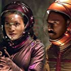 Eddie Murphy and Rosario Dawson in The Adventures of Pluto Nash (2002)