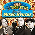 Moe Howard, Larry Fine, and Curly Howard in Punch Drunks (1934)