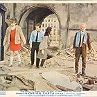 Peter Cushing, Bernard Cribbins, Jill Curzon, and Roberta Tovey in Daleks' Invasion Earth 2150 A.D. (1966)