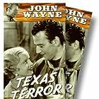 John Wayne and Lucile Browne in Texas Terror (1935)