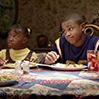 Tequan Richmond and Imani Hakim in Everybody Hates Chris (2005)