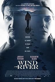 Elizabeth Olsen and Jeremy Renner in Wind River (2017)