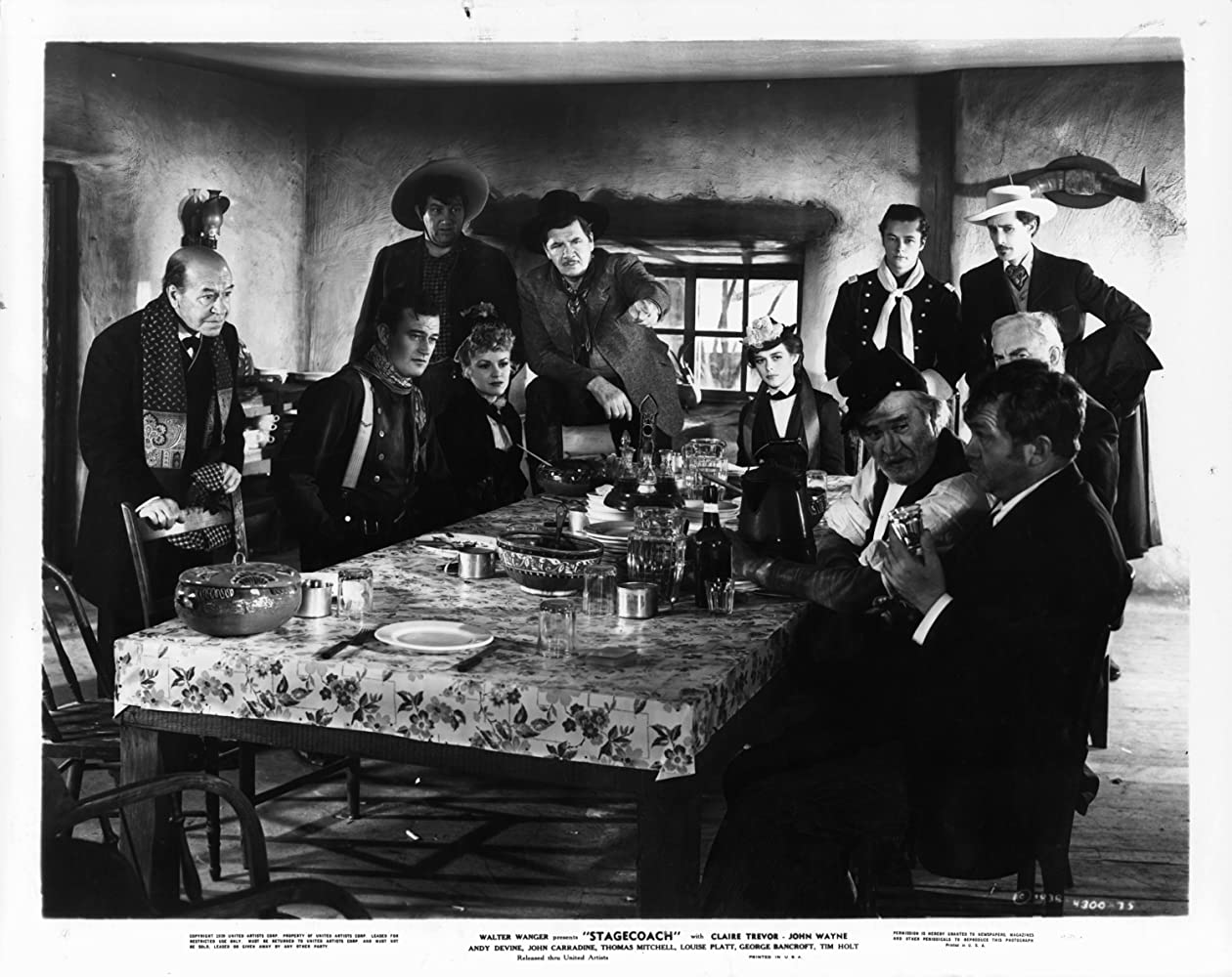 John Wayne, John Carradine, George Bancroft, Berton Churchill, Andy Devine, Francis Ford, Tim Holt, Donald Meek, Thomas Mitchell, Louise Platt, and Claire Trevor in Stagecoach (1939)