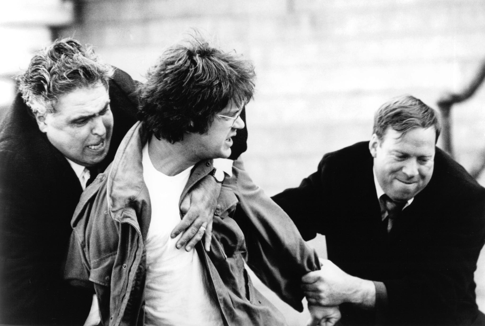 Tim Robbins, John Capodice, and John Patrick McLaughlin in Jacob's Ladder (1990)