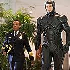 Marianne Jean-Baptiste and Joel Kinnaman in RoboCop (2014)