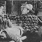 Budd Buster and Max Terhune in Texas to Bataan (1942)
