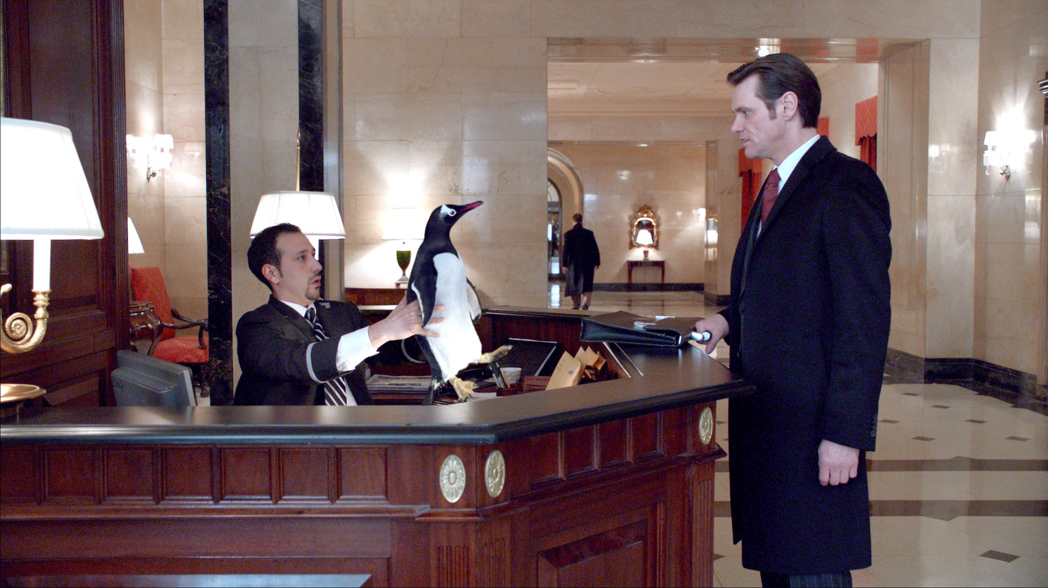 Jim Carrey and Desmin Borges in Mr. Popper's Penguins (2011)