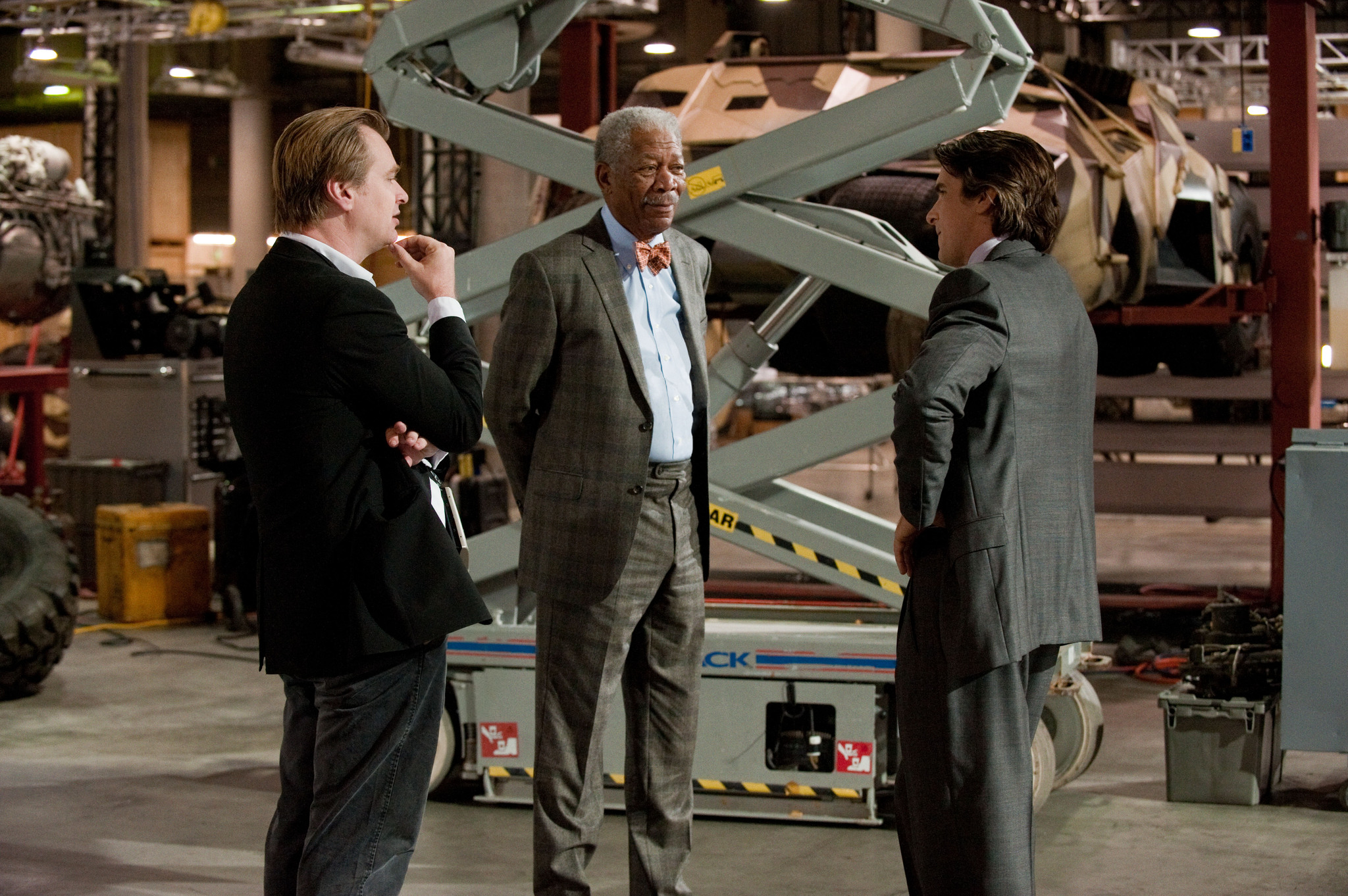 Morgan Freeman, Christian Bale, and Christopher Nolan in The Dark Knight Rises (2012)