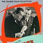 Robert Lowery, Donald MacBride, Sidney Toler, and Marjorie Weaver in Murder Over New York (1940)