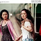 Gong Li and Yuelin Shi in Zhou Yu de huo che (2002)