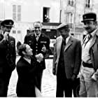 Mel Ferrer, Mark Burns, Robert Dhéry, Christopher Miles, and Philippe Noiret in A Time for Loving (1972)
