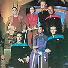 Terry Farrell, Colm Meaney, Nana Visitor, Avery Brooks, Armin Shimerman, Rene Auberjonois, Cirroc Lofton, and Alexander Siddig in Star Trek: Deep Space Nine (1993)