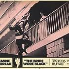 Jeanne Moreau and Claude Rich in La mariée était en noir (1968)
