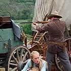 Emily (Tamara Hope) and pioneers under attack