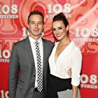 Erin Cahill and Ryan Carlberg at an event for 108 Stitches (2014)