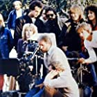 """Don Simpson, director Adrian Lyne, and Jennifer Beals on the set of """"Flashdance""""."""