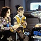 Lacey Chabert and Jack Johnson in Lost in Space (1998)