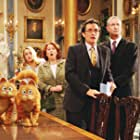 Lucy Davis, Oliver Muirhead, and Roger Rees in Garfield: A Tale of Two Kitties (2006)