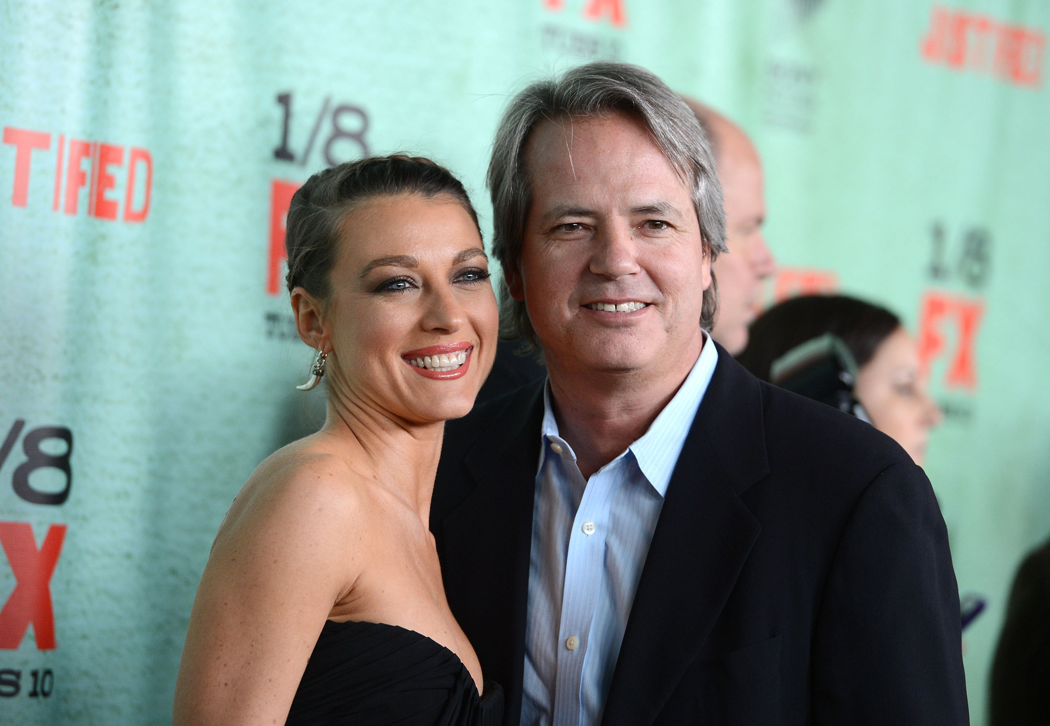 """Natalie Zea and Graham Yost attend the Premiere Of FX's """"Justified"""" Season 4."""