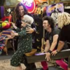 """Eve Brenner (in the catapult) with Steve Valentine, Stephen Full, and Greg Baker on """"I'm in the Band"""""""