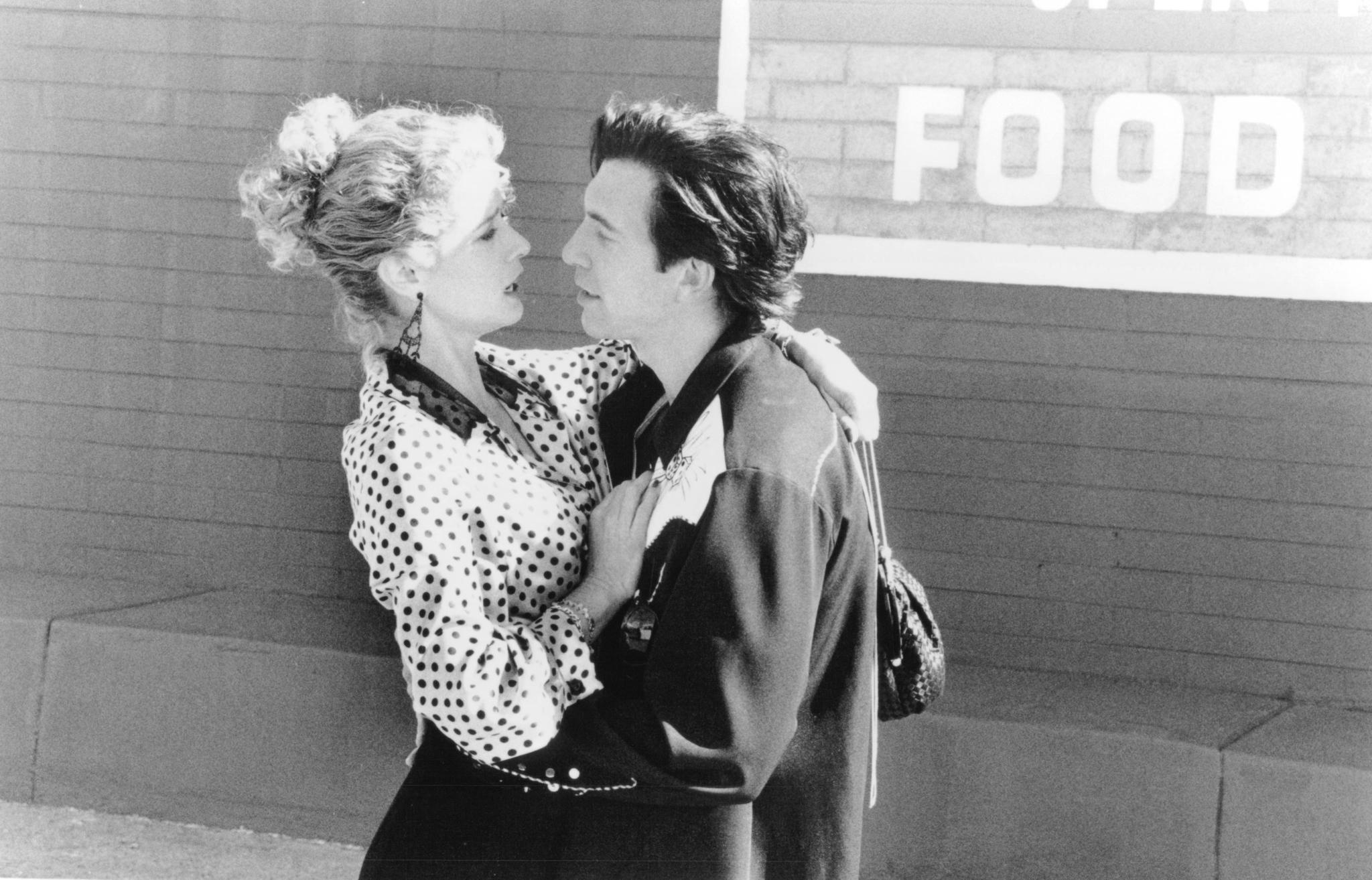 Dylan McDermott and Nancy Travis in Destiny Turns on the Radio (1995)