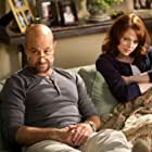 Stanley Tucci and Emma Stone in Easy A (2010)