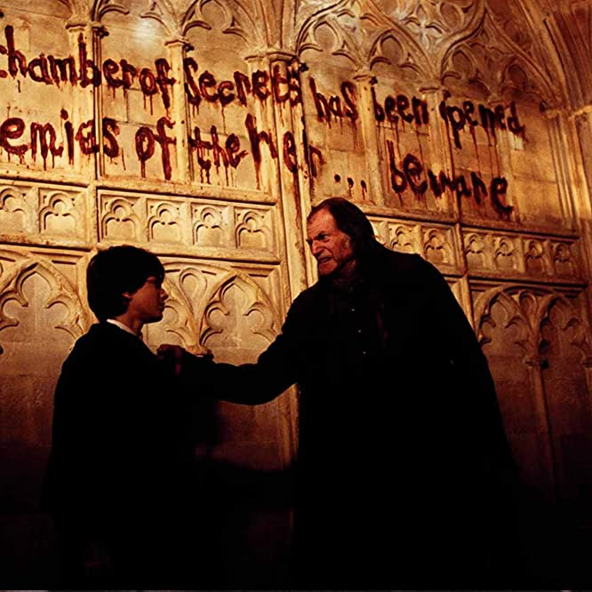 David Bradley and Daniel Radcliffe in Harry Potter and the Chamber of Secrets (2002)