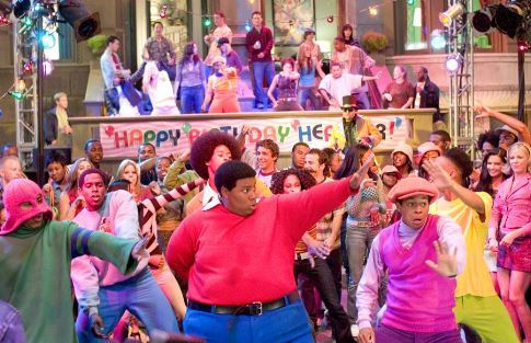 Fat Albert (Kenan Thompson, front, center) and friends wow partygoers with their dance moves.