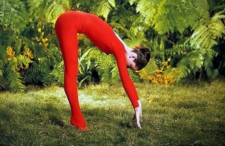 """33-2276 Audrey Hepburn doing exercises on the MGM set of """"Green Mansions"""""""