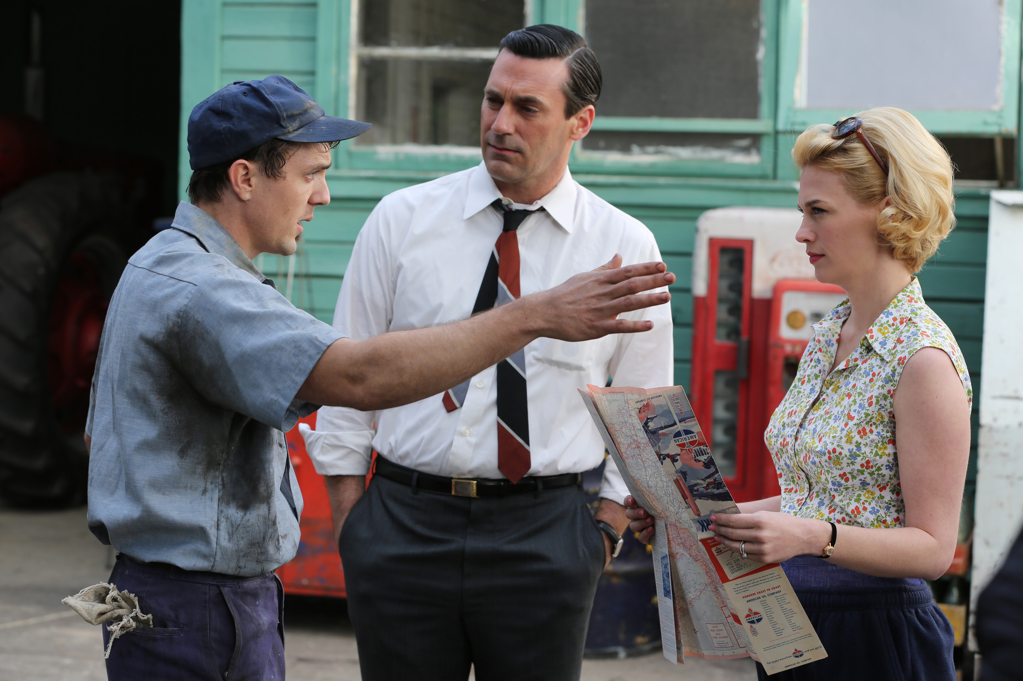 January Jones, Jon Hamm, and Lucius Baybak in Mad Men (2007)