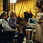 Director Val Waxman (WOODY ALLEN) and studio executive Ellie (TÉA LEONI) compliment Lori (DEBRA MESSING) on her scene in Woody Allen's latest contemporary comedy HOLLYWOOD ENDING, being distributed domestically by DreamWorks.