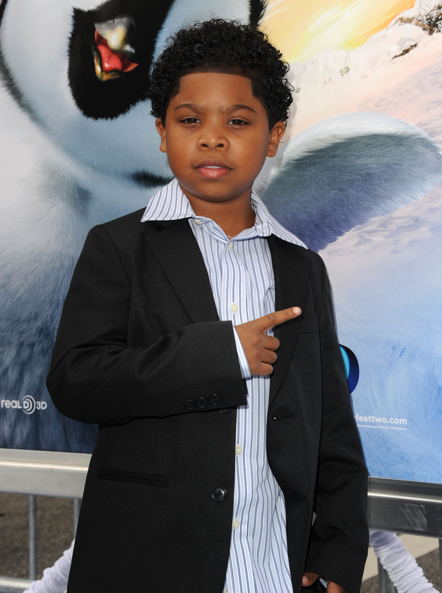 Benjamin Flores Jr. at an event for Happy Feet Two (2011)