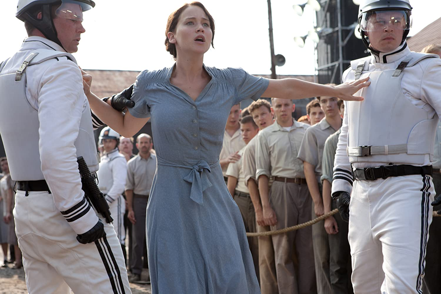 Anthony Reynolds Judd Lormand and Jennifer Lawrence in The Hunger Games 2012