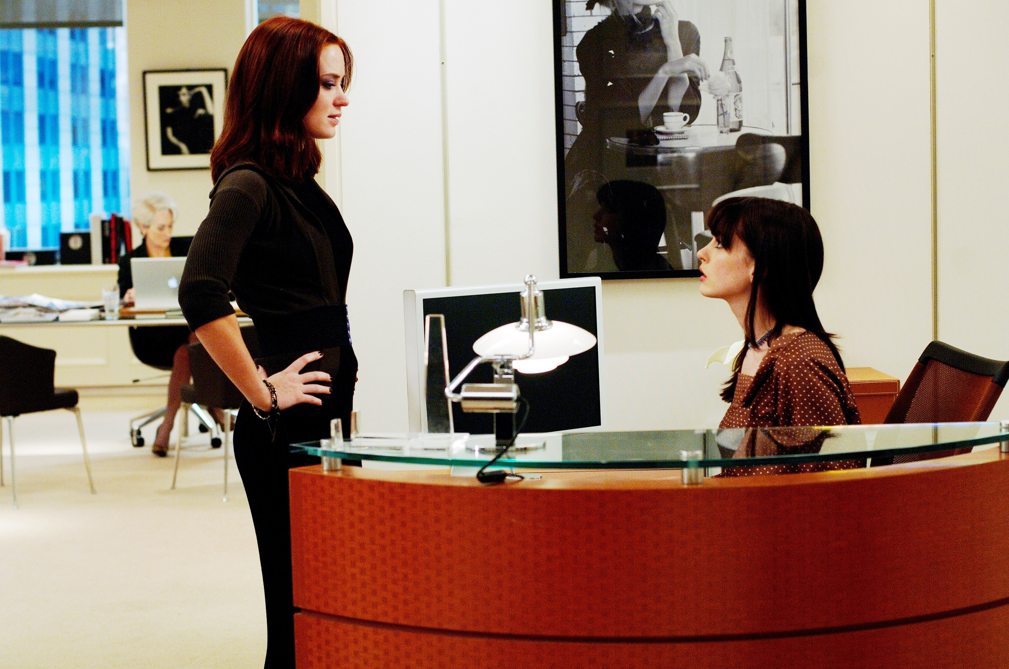 Anne Hathaway and Emily Blunt in The Devil Wears Prada (2006)