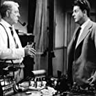 Jean Desailly and Jean Gabin in Maigret tend un piège (1958)