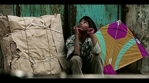 In the old city of Ahmedabad, amid India's largest kite festival, a family duels, spins and soars like the countless kites in the skies above.