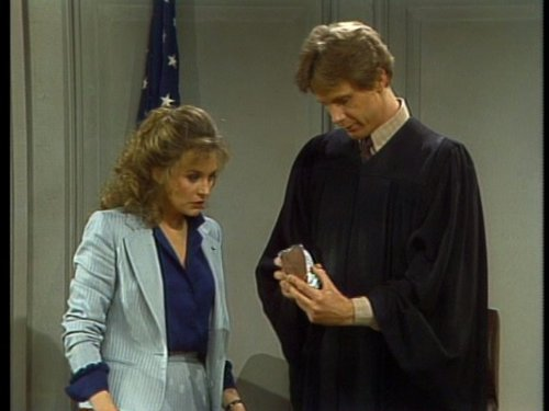 Harry Anderson and Karen Austin in Night Court (1984)