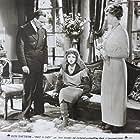 Ruth Chatterton, Geoffrey Kerr, and Gwendolyn Logan in Once a Lady (1931)