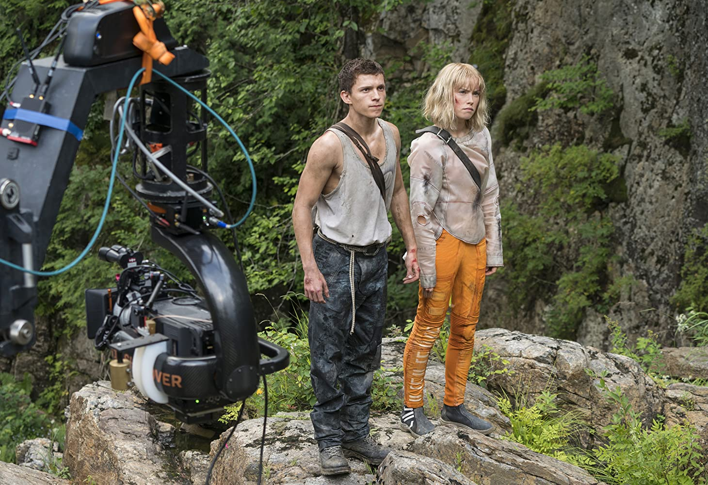 Chaos Walking film still of two people standing on a rock