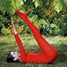 """33-2272 Audrey Hepburn doing exercises on the MGM set of """"Green Mansions"""""""