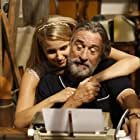 Robert De Niro and Dianna Agron in The Family (2013)